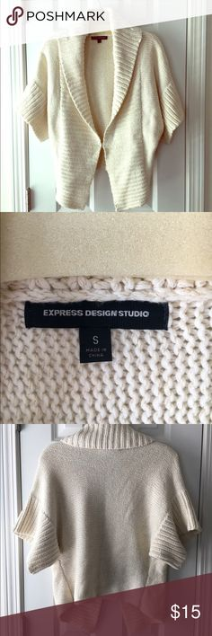 Express studio short sleeve sweater This cute sweater has a hook in the front to close it, and it's super soft, excellent condition. Express Sweaters Cardigans