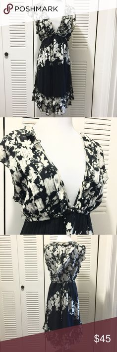 Free People Floral Dress Black with off white Floral print. Excellent condition. Cotton loose comfortable fit, attached self tie string belt Free People Dresses Midi