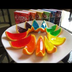 Jello-shots! (no need to add alcohol, these would be fun for my nieces and nephews for snack!) Gut two orange halves and fill with jello mixture, refrigerate like normal, then slice!