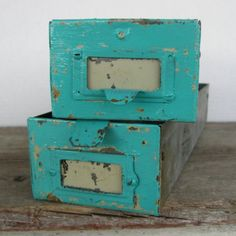 An herb garden would look beautiful in these vintage metal drawers, let's tuck away for next spring.