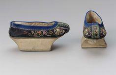 Pair of woman's shoes (gi xie) circa 19th century. Manchu woman's shoe black silk satin shoe with concave platform heals.  Museum of Fine Arts, Boston