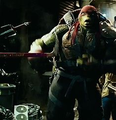 Raphael putting his hands up while looking at Michelangelo & also looking at Casey Jones.