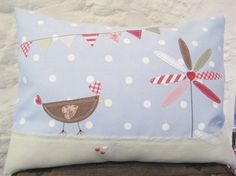 Applique Hen, Flower and Bunting Cushion - love the fringing of the linen panel