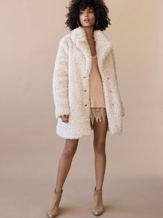 Lux Faux Fur Coat With Printed Lining | Ultra luxe faux fur coat with a cozy feel and a pretty blush hue. Bold printed lining offers a unique detail to the look.