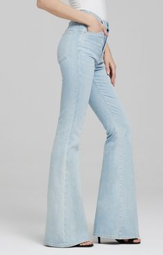 Channeling a cool, 1970s mood, our Cherie flare jeans have a long silhouette and high waist. Our signature stretch denim gives them a figure-flattering, smooth shape and the bright blue wash has a vibrant, lively feel. They're like something Farrah Fawcett might have worn on the Charlie's Angels set. Enhance the long look with platforms and a vintage blouse.