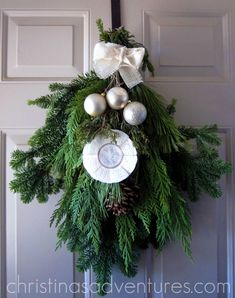 A new take on a Christmas wreath - use this fresh decorated greenery swag on your front door instead!
