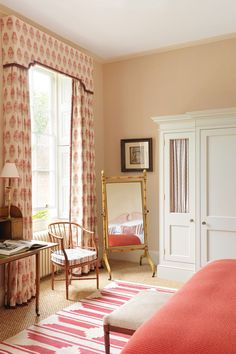 The curtains are in 'Mughal Flower' linen from Lisa Fine Textiles.
