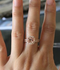 Morganite Engagement Ring Set in 14K Rose Gold Halo Diamond Setting. This girl is unfortunate confused about which finger the ring goes on, though