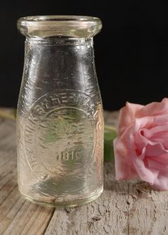 Vintage Milk Bottle 4.5 in.  This website it great for little bottles and other discount wedding stuff!  save-on-crafts.com