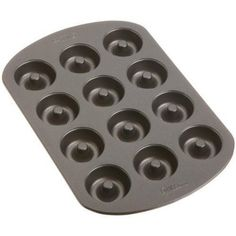 Wilton Mini Doughnut Baking PAN 12 Nonstick Cavities Mini Cakestreats >>> Read more  at the image link.