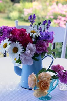 Aiken House & Gardens: Relaxing on the Porch (garden bouquets and a enamelware coffee pot)