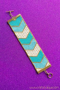 PRETTY CHEVRONS - BEAUTIFUL PEYOTE STITCH BEADED BRACELET PATTERN ****THIS PATTERN USES MIYUKI DELICAS SIZE 10/0**** The gorgeous turquoise, white and gold colours in this pattern combined with the pretty chevron design work so well together, making this an exciting bracelet to bead - and wear! Talk about stylish! When the bracelet is made up according to the pattern, it will measure approx. 5.5 inches in length and just over 1.4 inches wide. With a toggle clasp added, the bracelet wi...