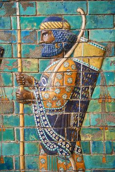Coloured glazed terracotta brick panels depicting Achaemenid Persian royal bodyguards or archers. From the reign of Darius 1st and the First Persian or Achaemenid Empire around 510 BC excavated from the Palace of Daius 1st Susa, present day Iran. . The Vo   Photos Gallery