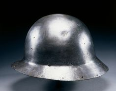 Kettle Hat (War Hat) Kettle Hat (War Hat), c. 1460 Italy, 15th century steel, Overall - h:30.30 w:25.90 d:17.50 cm (h:11 7/8 w:10 3/16 d:6 7/8 inches) Wt: 5.52 kg. Gift of Mr. and Mrs. John L. Severance 1916.1919 Location:  Gallery 210