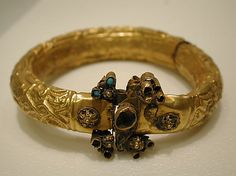11-12th c. Syrian bracelet, repousse gold sheet with punching, twisted wire, and granulation - Met Museum 58.37