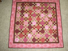 Snowball and nine patch baby quilt. Ruby's baby quilt.