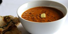 This traditional lentil dhal recipe from Alfred Prasad features a lovely buttery makhni sauce with tomatoes, garlic, ginger and spices.
