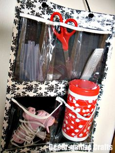 cheap dollar store organizer with ...duct tape edges!  Great craft supplies storage!