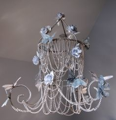 Believe it or not, this butterfly chandelier is a dollar store craft made from a tomato cage and other little bits.  I will do this one for sure!