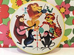 Kitsch vintage Williams's toffee tin with Animal Band