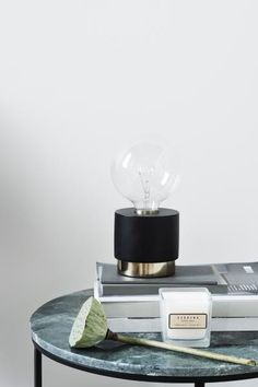 Table lamp in painted mango wood and metal. Fabric-covered cord with a plastic switch and bulb holder. Rustic Floor Lamps, Black Table Lamps, The Frugality, Magazine Deco, Luminaire Design, Can Lights, Desk Light, Fancy, Wood And Metal
