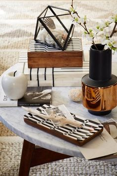 Style Your Place Like A Home Catalog — All The Tricks #refinery29  http://www.refinery29.com/2014/07/70895/west-elm-fall-2014-collection#slide-5  A clear, glass case is ideal for displaying beach finds.