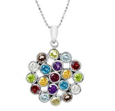 The circular design of this pendant is beautifully adorned with a collection of the finest gemstones which range from Citrine to Lemon Quartz, White Topaz, Sky Blue Topaz, Amethyst, Peridot, Mozambique, Smoky Quartz and Rhodolite.