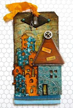 Great steampunk tag!!  Barbara outdid herself with the colors, techniques and just look at the zippers!!  great urban tag.  yaya scrap & more