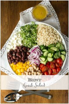 Fresh veggies, Feta, olives, cannellini beans, pearl pasta, and a vibrant, easy dressing - this might be the best Greek salad ever! via @cafesucrefarine