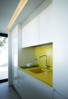 Yellow Kitchen Nook via @CONTEMPORIST .com - not sure if I would use yellow myself, but like the color against the white