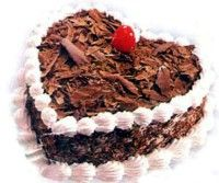 Rich chocolate cake in a feminine heart shape will melt her heart as Ukraine gift on Valentine's Day.