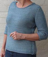 Пуловер с косами женский спицами