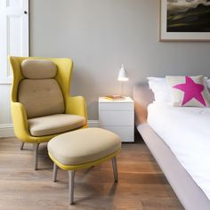 Ro chair from Fritz Hansen featured in this interior project by Tangram! The bold yellow works beautifully with the pink to create a stylish and feminine #bedroom
