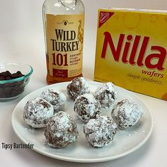 WILD TURKEY BALL BROWNIES 10 oz. Nilla Wafers crushed into crumbs 1 Cup Pecans Grounded 1/2 Cup Powered Sugar  6 oz. Chocolate Chips 1/2 Cup Wild Turkey Bourbon 3 Tbsp Light Corn Syrup
