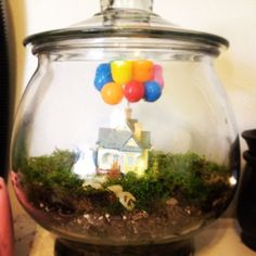 Pinned by Brittany Hall. Now that's cute as well as thinking outside the box. Theme a terrarium after a favorite scene in a movie or a scene from a book you see in your head... Hmmm