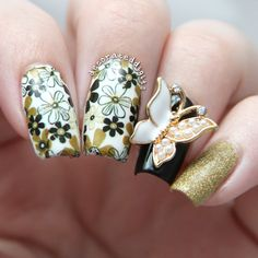 Black, white and gold floral butterfly nails by decorateddigits