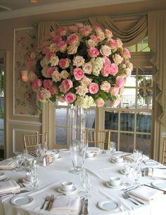 Pastel pink and cream roses for this ravishing center piece. Lovely, isn't it? :)  #flowerstationnj #weddings #love #flowerarrangements