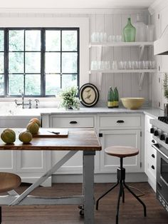 Turn an old table (this kitchen used a late-1800's Belgian butcher's table) into a kitchen island. It's an easy way to make your kitchen unique! #kitchen #decoratingideas
