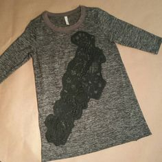 Free People Top Beautiful Black Heather Top with see through black lace crochet inlay, black and grey top 3/4 sleeve.  Shirt has slight flare at the bottom.  Use offer button, make an offer ? Free People Tops
