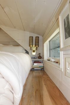 A 196-square-feet tiny house with a loft bedroom, living/dining space, a surrounding garden, and the perfect kitchen to accommodate small living.