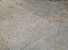 Cathedral flagstones antiqued. Grey green in tone this limestone is suitable for interior and exterior design projects. www.naturalstoneconsulting.co.uk