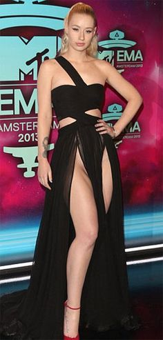 Iggy Azalea wears revealing dress.  Iggy Azalea wore a stylish very daring and revealing dress at 2013 MTV European Music Awards. She wore a daring long black dress which had one shoulder strap as well as cut-  outs in the midriff section. Check out at:http://www.womenfitness.net/news/other/iggyAzalea_revealingDress.htm