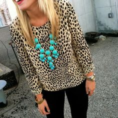 Not sure if I like the shirt, but I love the bright blue against the cheetah print!
