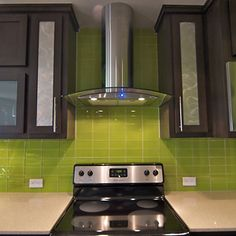 lime green subway tile backsplash. kind of liking the dark wood/brown cabinets, with green backsplash/white counters