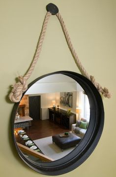 As seen on HGTV's Elbow Room, you can add visual interest and depth by hanging mirrors in stairwells and other areas of your home. Round Hanging Mirror, Rope Mirror, Converted Barn Homes, Cool Garages, Home Catalogue, Secret Rooms, Room Pictures, Room Accessories, Hgtv