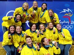 The Australian women's water polo team celebrate with their gold medals after defeating the USA team 4-3 at the 2000 Summer Olympics in Sydney, Sept. 23, 2000.