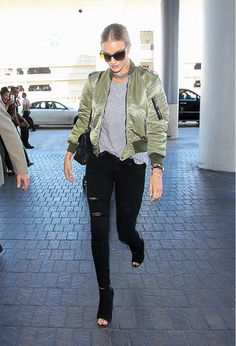 Rosie Huntington-Whiteley wears a bomber jacket with a gray T-shirt, black distressed jeans and open toe booties.