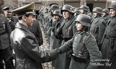 "Joseph Goebbels awards the 16-year old Hitler Youth member ""Willi Hübner"" the Iron Cross for the defense of Lauban. March 9, 1945. You can find more colorized photos here https://www.facebook.com/profile.php?id=100008268661999 or https://www.pinterest.com/cosmicpretzel/colorized-ww2-photos/"