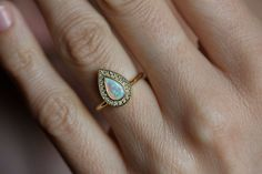 Black Friday SALE -15% discount on all items     Stunning hand-crafted pear-shaped Opal ring with a Diamond pavé halo.  Product details Middle gemstone