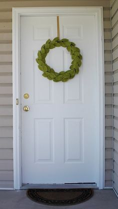 Check out this tutorial featured on dollar store crafts. ( DIY wreath for under 5 Dollars )